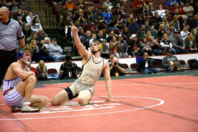 Tribune Chronicle file / Joe Simon Pymatuning Valley's Gaige Willis, right, points to family in the stands after winning the Division III 195-pound state title in March at Columbus.