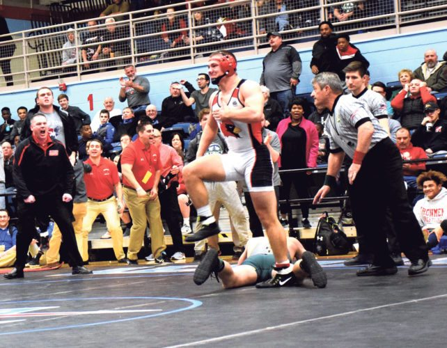Tribune Chronicle file / Joe Simon Canfield's David Crawford reacts after winning a Division II district title on March 4 at Alliance High School. Crawford went on to win the state title at 170 pounds and returns as a favorite to win another one.
