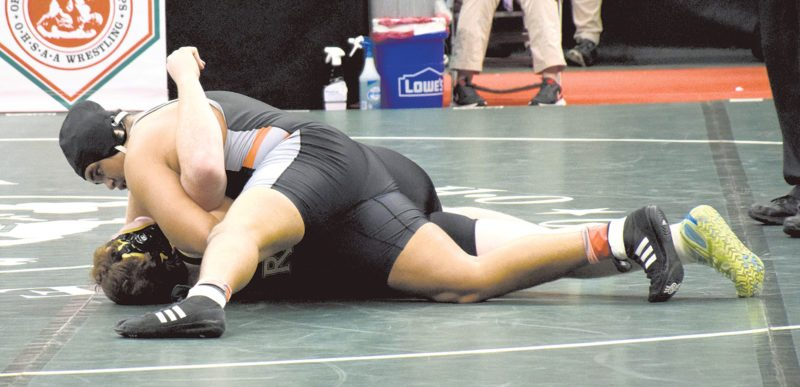 Tribune Chronicle file / Joe Simon Howland wrestler Brandon Matlock, top, is moving from the 285-pound weight class, where he finished fourth in the state in Division II last year, to the 220-pound class.