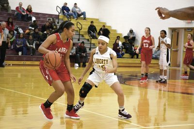 Tribune Chronicle / John Vargo LaBrae's Marissa Roberts, left, dribbles up the floor as Liberty's Erilynn Stevens provides pressure during Monday's game at Liberty High School. The Leopards used their speed and toughness to handle the Vikings, 66-35.