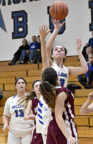 Tribune Chronicle / Marc Weems Annie Pavlansky of Lakeview shoots over Boardman's Alicia Saxton in the Bulldogs' 46-28 win over the Spartans Wednesday at Cortland.