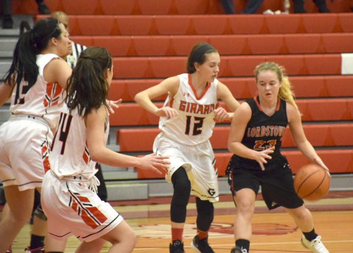 Tribune Chronicle / John Vargo Lordstown's Jordan Beach dribbles against Girard defenders including Emily Fitzgerald (12) Wednesday at Girard.