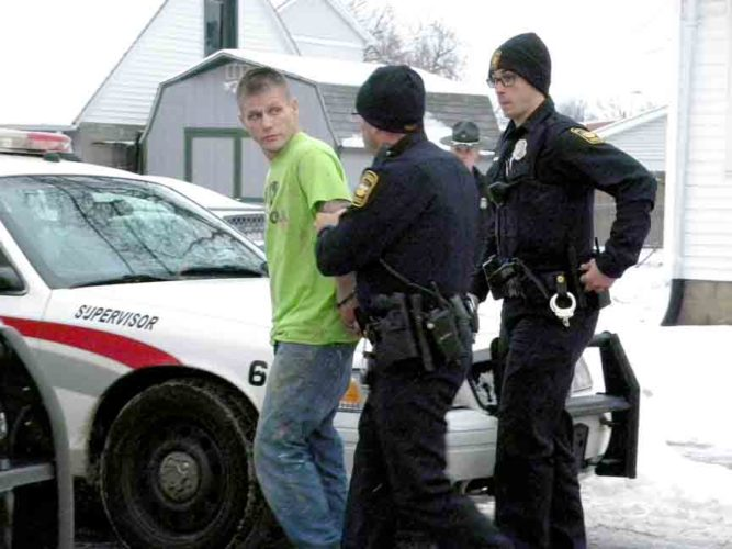 Tribune Chronicle / Jon Wysochanski Police take a man into custody outside a home on John Street in Niles Friday afternoon after the man was found hiding out there following a robbery at PNC Bank in Liberty and a police chase. The man, identified by Liberty police Sgt. Ray Buhala as Michael Scott Williams, 36, was booked into the Trumbull County Jail on charges of robbery, receiving stolen property and failure to comply.
