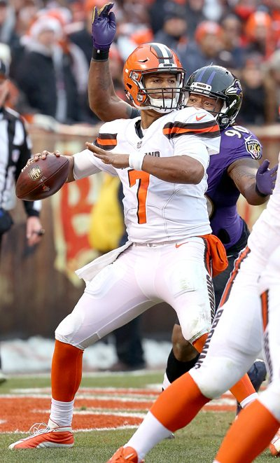 Tribune Chronicle / Michael Taylor Cleveland's DeShone Kizer (7) is stripped of the ball by Baltimore's Za'Darius Smith (90) during the third quarter Sunday.
