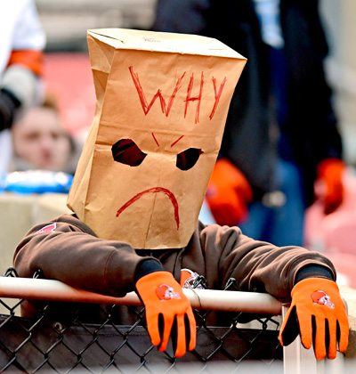 Tribune Chronicle / David Dermer A Cleveland Browns fan sits in the stands while wearing a paper bag on his head during the second half of a game between the Baltimore Ravens and Cleveland Browns on Sunday afternoon at FirstEnergy Stadium. The Ravens won 27-10.