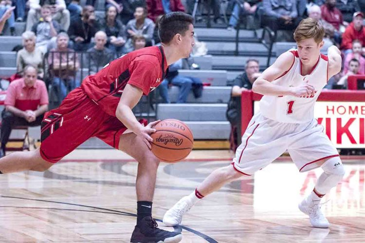 Special to Tribune Chronicle / Dianna Oatridge Girard's Austin Claussell, left, dribbles up court as LaBrae's Connor Meyer guards during Tuesday's game in Leavittsburg.