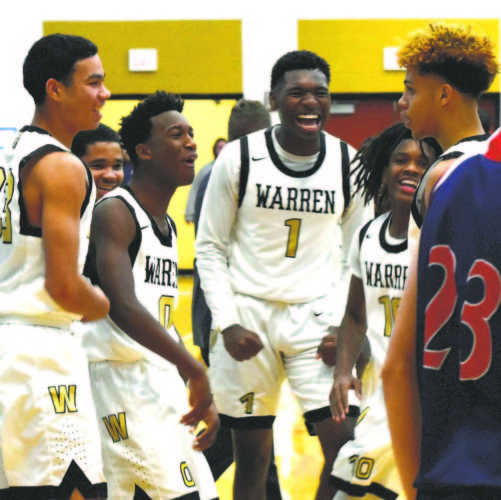 Tribune Chronicle / Joe Simon Warren G. Harding players, from left, Tye Pennington, Delshawn Redd, Terrion Jackson, D'Muntize Owens and Elizah Smith celebrate after Smith hit a long 3-pointer just before the third-quarter buzzer sounded on Tuesday in a matchup with Austintown Fitch. Harding won, 68-47.