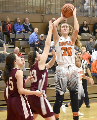 Tribune Chronicle / Joe Simon Howland's Alex Ochman, right, goes up for a shot over Boardman's Annalisa Cordova during their game Wednesday in Howland. The Tigers won, 67-31.