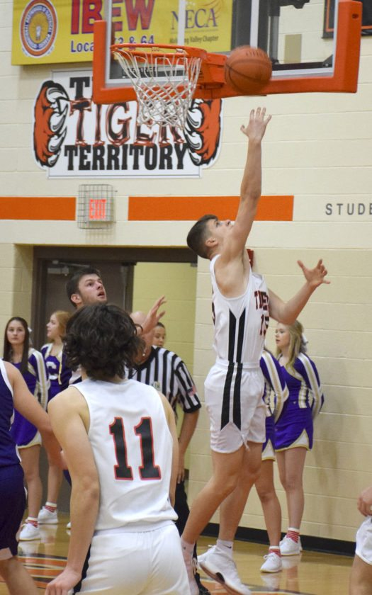 Tribune Chronicle / John Vargo Howland's Branden Fronzaglio makes a reverse layup during Friday's game against Champion at Howland High School.