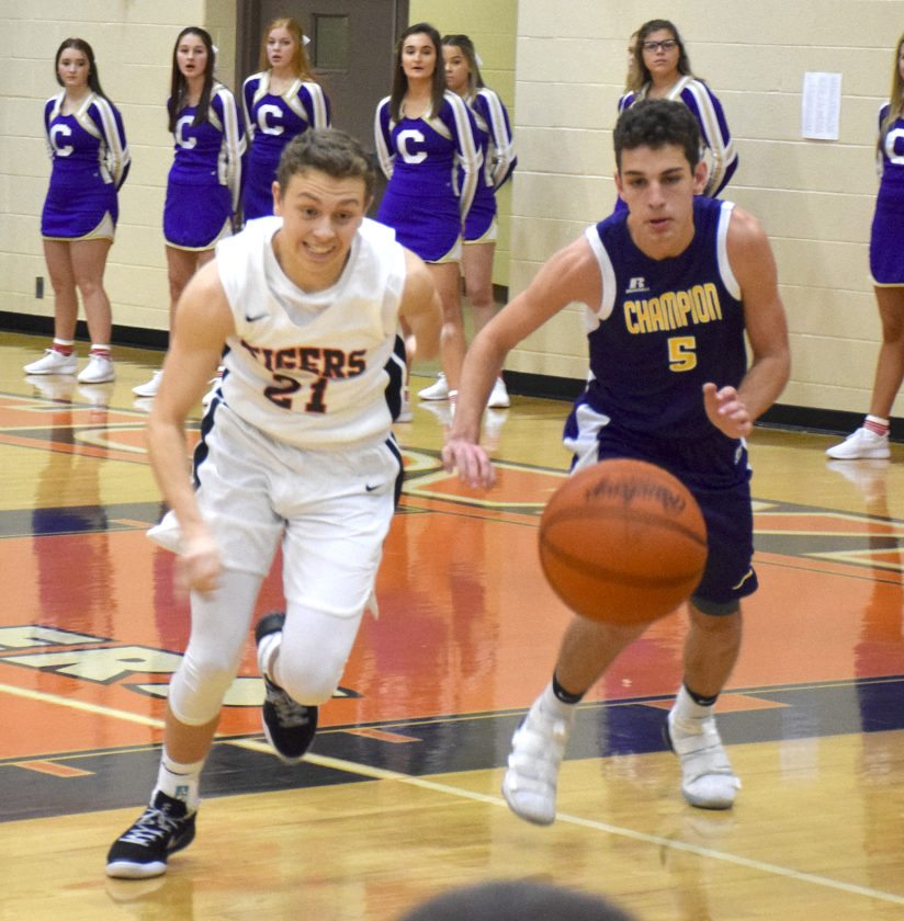 Tribune Chronicle / John Vargo Howland's Frankie Manios, left, and Champion's Joe Abramovich, right, chase the loose ball during Friday's game at Howland High School.