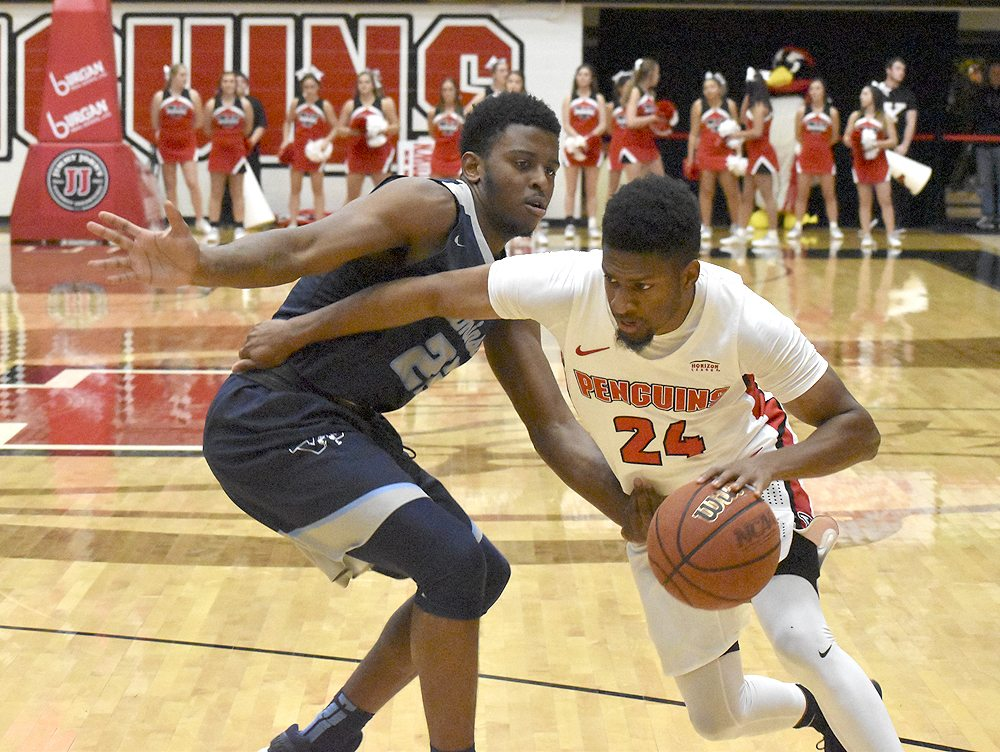 Tribune Chronicle file / Marc Weems Cameron Morse (24) leads the YSU Penguins into their game Friday at Indiana.