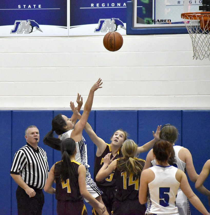 Tribune Chronicle / Marc Weems Emily Williams of Jackson-Milton gets a shot off from among a crowd during the Blue Jays' win Wednesday over Southeast.