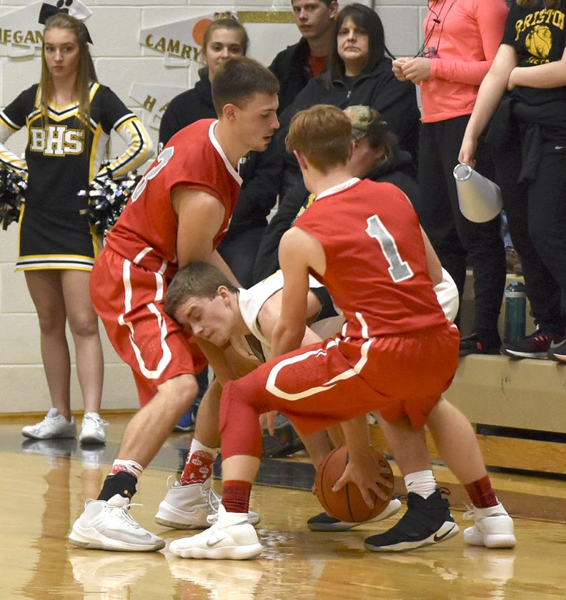 Tribune Chronicle / Joe Simon Bristol's Damian Durst, center, is guarded by LaBrae's Aaron Iler, left, and Connor Meyer (1). The Vikings beat Bristol, 81-58.