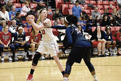 Tribune Chronicle / Marc Weems YSU's Sarah Cash, left, looks to pass while being guarded by Detroit Mercy's Brianne Cohen on Thursday. The Penguins defeated Detroit Mercy, 76-59.