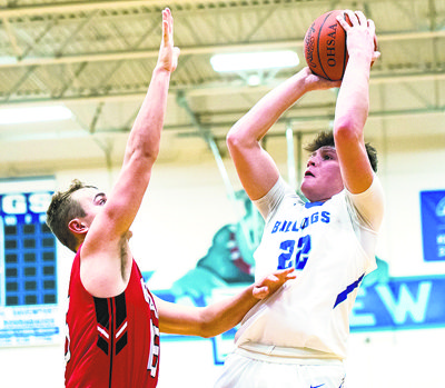Special to Tribune Chronicle / Dianna Oatridge Lakeview's Drew Munno, right, goes up for a shot over Girard's Mark Waid during their game Friday in Cortland. Lakeview won, 64-57.