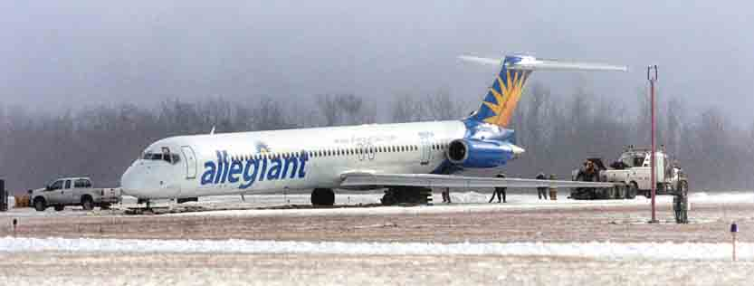 Tribune Chronicle / R. MIchael Semple An Allegiant Air passenger jet sits off the taxi way Tuesday afternoon at the Youngstown-Warrren Regional Airport.