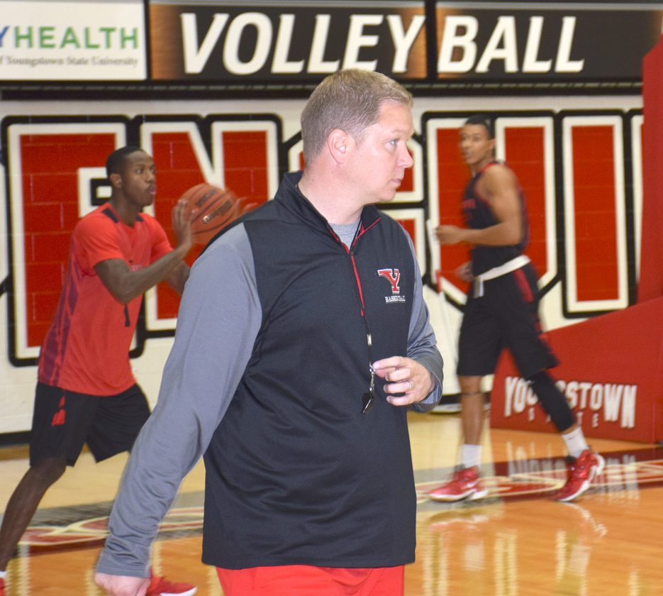 Tribune Chronicle file photos Youngstown State went in a new direction with its men's basketball program, hiring Jarrod Calhoun after the retirement of longtime coach Jerry Slocum.