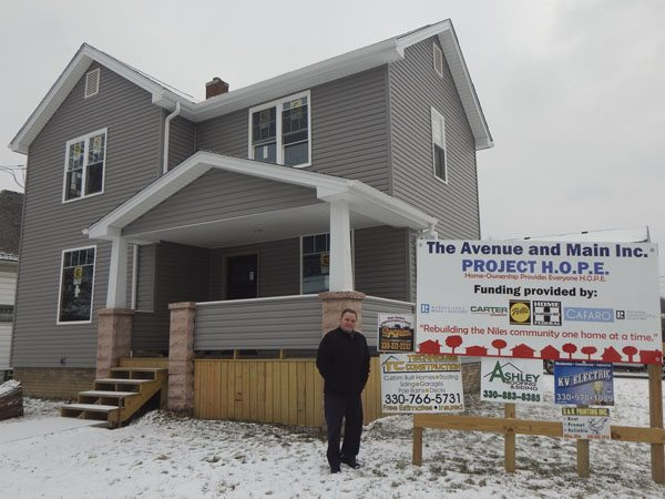 Jeff Crowley with the Avenue and Main shows the completed exterior of a home on Cedar Street, Niles which is nearing completion as part of Project Hope.