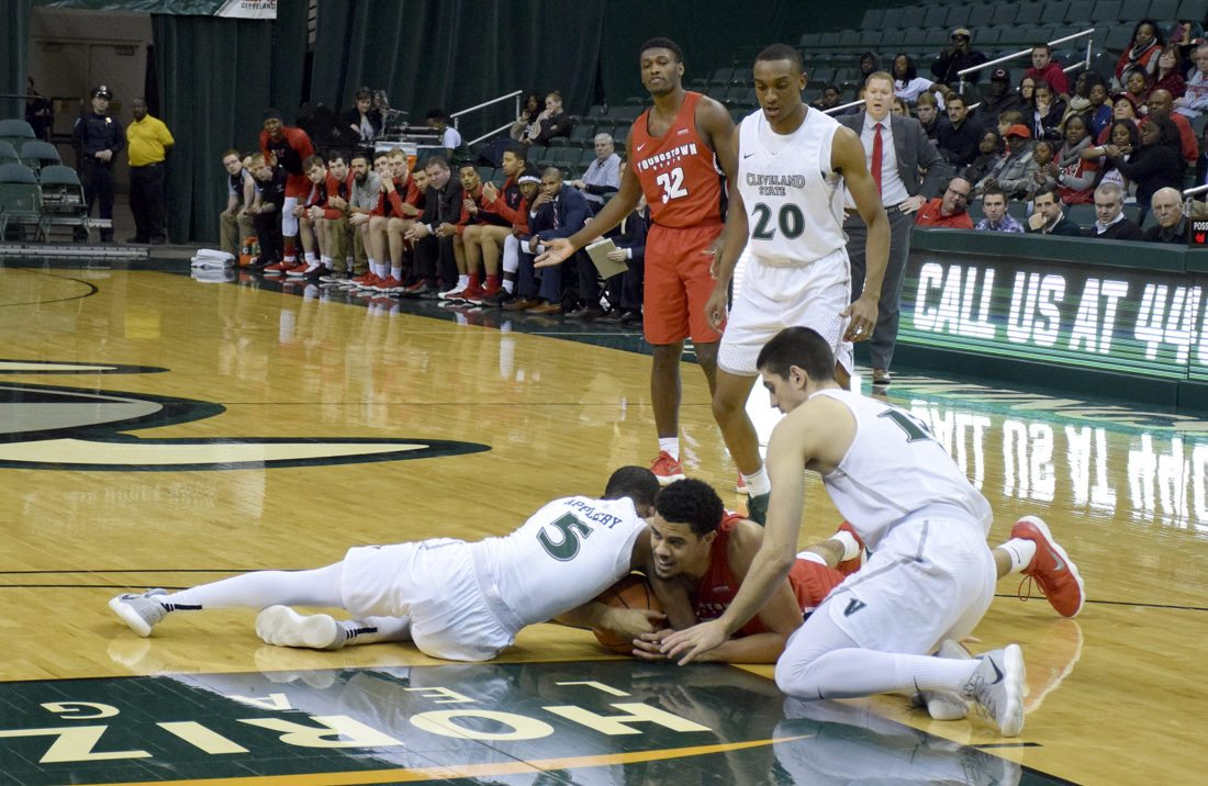 YSU's Devin Haygood and Cleveland State's Tyree Appleby fight for the loose ball during the first half of Monday's game at Cleveland State. YSU won, 80-77.