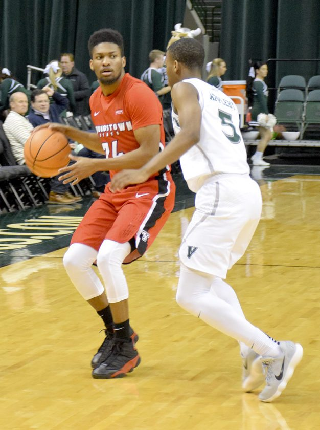 Cleveland State's Tyree Appleby guards YSU's Cameron Morse during the first half of Monday's game in Cleveland. Morse hit the game-winning 3 with 0.6 seconds left as YSU won. 80-77.
