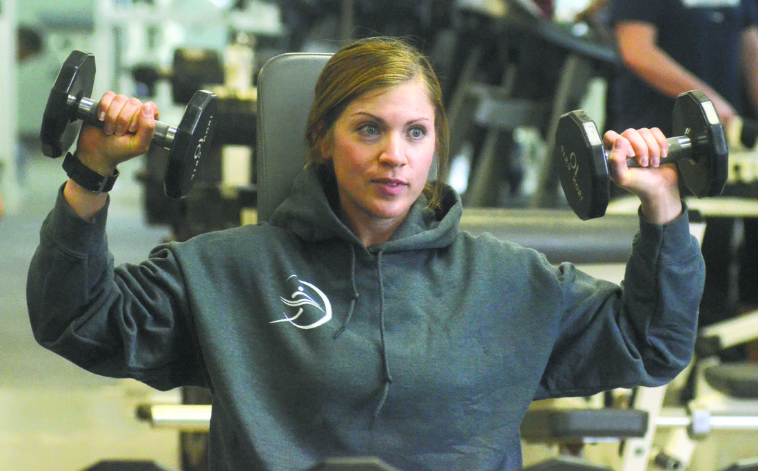 Sharon Rodhe of the LPJ Lean Machine team in the 2017 Tribune Chronicle / Mercy Health Fitness Challenge tracks her form in a mirror while lifting weights at the Q-Club Health and Aquatic Center in Howland.