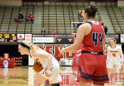 Tribune Chronicle / John Vargo Youngstown State's Sarah Cash grimaces as she is called for traveling during the first quarter of Thursday's game in Youngstown. UIC's Teodora Zagorac is also pictured.