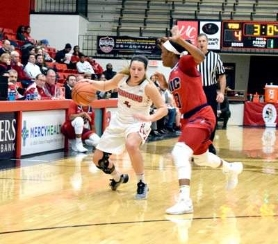 Tribune Chronicle /John Vargo Youngstown State's Nikki Arbanas tries to break free of the defense of UIC's Brittany Boyd during the first quarter of Thursday's game in Youngstown. The Penguins won, 76-63, over the University of Illinois-Chicago at the Beeghly Center.