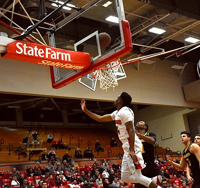 Tribune Chronicle / John Vargo Youngstown State's Cameron Morse makes a layup in front on a Milwaukee defender during the first half of Thursday's game in Youngstown.