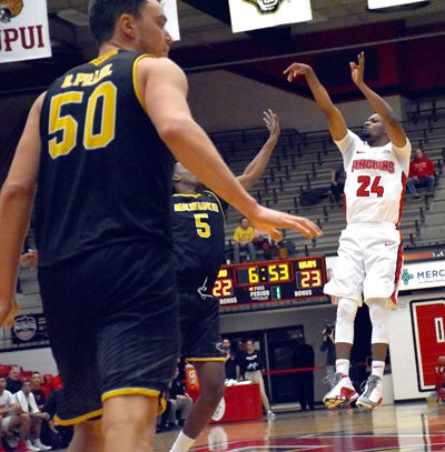 Tribune Chronicle / John Vargo Youngstown's Cameron Morse follows through with a made 3-pointer in front of Milwaukee's Caron Warren-Newsome during the first half of Thursday's game in Youngstown.