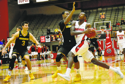 Tribune Chronicle / John Vargo Youngstown State's Braun Hartfield, right, drives as Milwaukee's Jeremiah Bell guards during the first half of their game Thursday.