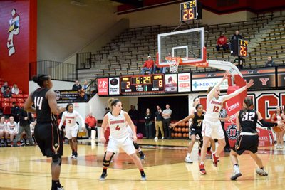 Tribune Chronicle / John Vargo YSU's Chelsea Olson (12) guards IUPUI's Jenna Gunn (32) during the first quarter of Saturday's game in Youngstown. IUPUI won, 65-43.
