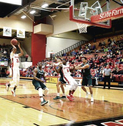 Tribune Chronicle / John Vargo YSU's Cameron Morse shoots a short jumper as Green Bay's PJ Pipes looks on Saturday in Youngstown.