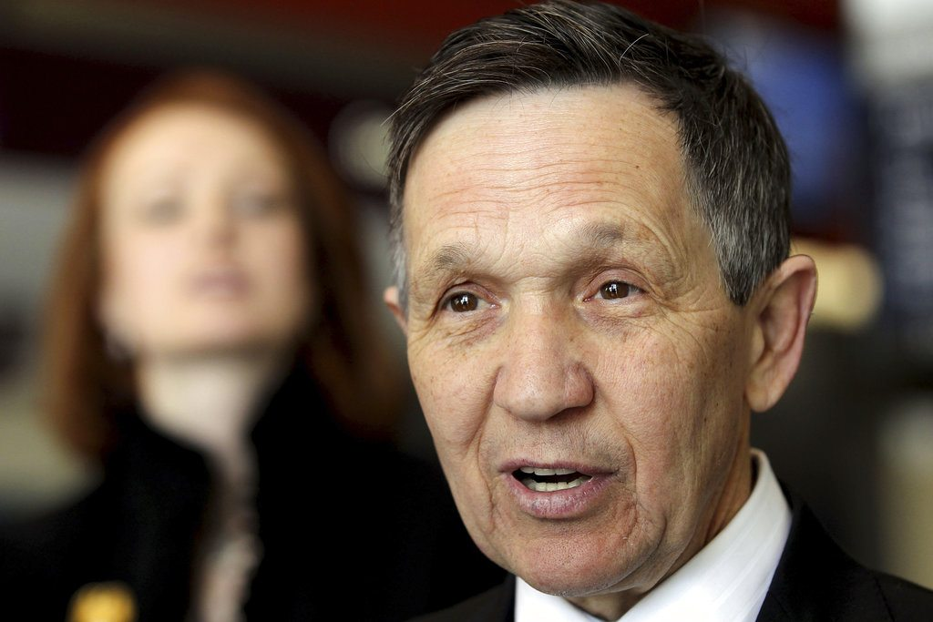 FILE- In this March 7, 2012, file photo, Dennis Kucinich speaks with reporters just before he boards a plane headed for Washington at the Hopkins International Airport in Cleveland. Former Cleveland mayor and U.S. Rep. Kucinich has filed paperwork indicating plans to join the race to become Ohio's next governor. The Democrat's filing Monday, Jan. 8, 2018, with the Ohio Secretary of State's office designated a treasurer for the Kucinich for Ohio campaign. (Lisa DeJong/The Plain Dealer via AP, File)