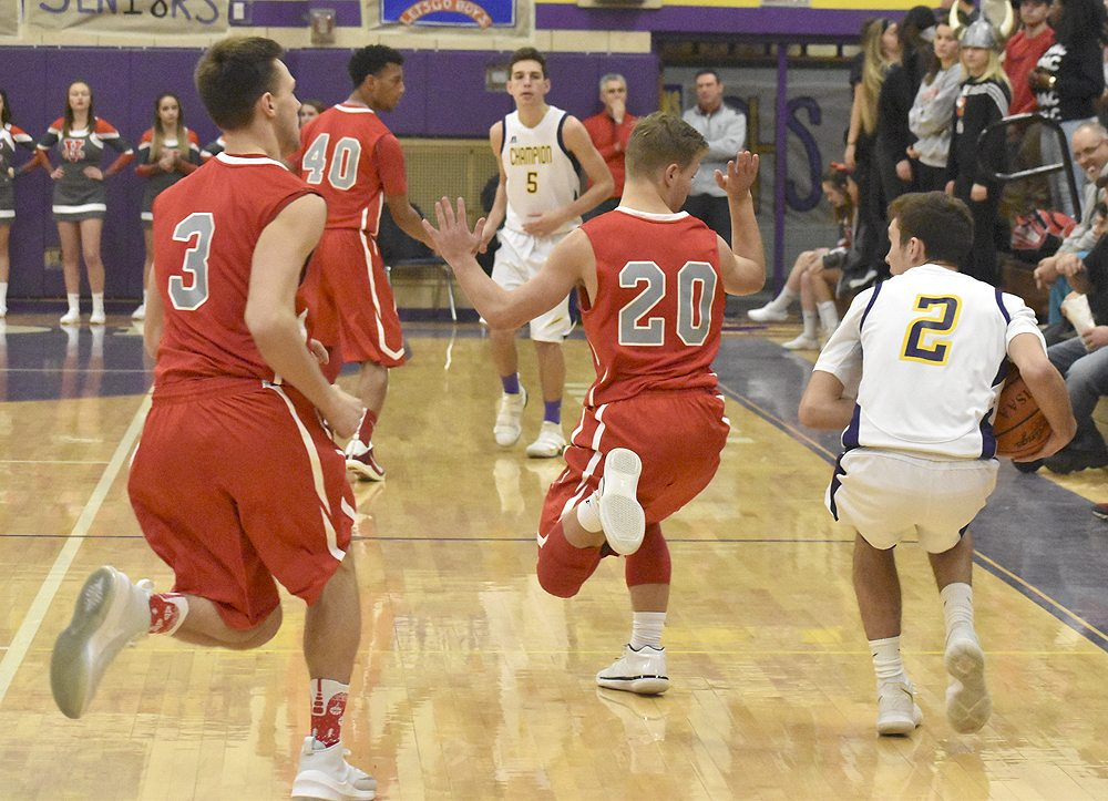 Tribune Chronicle / Marc Weems LaBrae's pressure defense tries to trap Champion's Chase Wheelock Tuesday night. Working to double-team the Flashes' guard are Aaron Iler (3) and Benton Tennant (20).