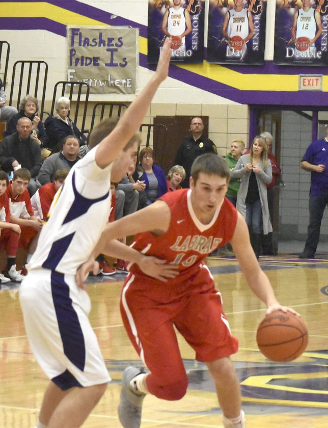 Tribune Chronicle / Marc Weems Logan Kiser, right, of LaBrae tries to dribble past Champion defender Nick Stahlman during the Vikings' win Tuesday.