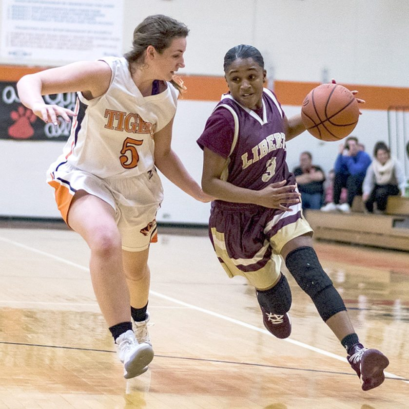 Special to Tribune Chronicle / Dianna Oatridge Newton Falls defender Bree Hutson, left, tries to keep Liberty's China Tate from driving the lane Wednesday night.