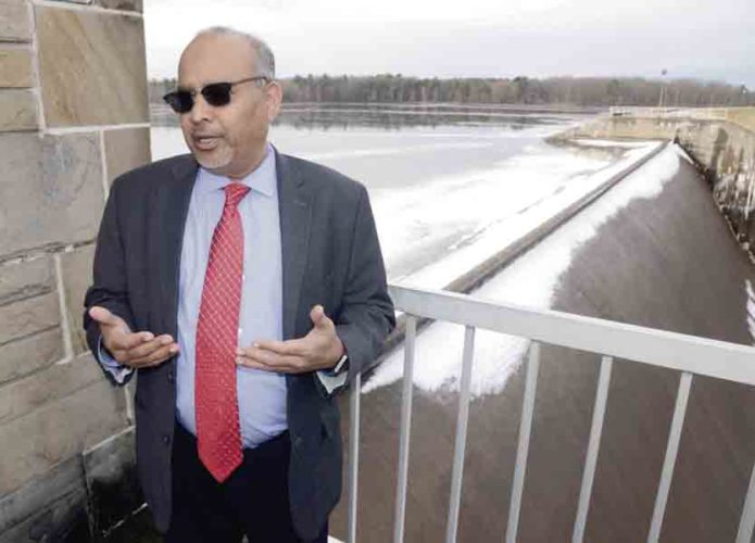 Tribune Chronicle / R. Michael Semple Mahoning Valley Sanitary District chief engineer Ramesh Kashinkunti talks about the Meander Dam while standing next to the dam's spillway. The dam is under an engineering review and could see millions of dollars in improvements in 2019.