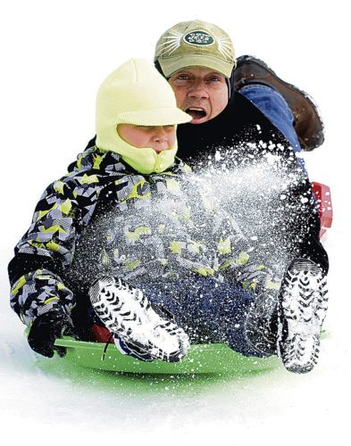 011518...R SLEDDING 5...Warren...01-15-18...Landyn Kozak, 7, left, and his grandfather John Lockwood, both of Girard, enjoy time together on MLK Day sled riding at Packard Park hill...by R. Michael Semple