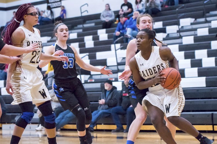 Special to Tribune Chronicle / Dianna Oatridge Kamarah Bender, right, of Warren G. Harding tries to get off a shot after getting past Lakeview's Beady Titus Wednesday night at Harding. Faith Burch (22) of Harding and Annie Pavlansky (33) of Lakeview watch the play. Harding beat Lakeview, 44-41.