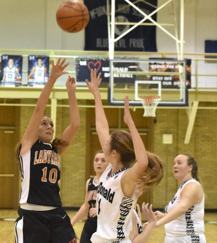 Tribune Chronicle / Marc Weems Taryn Kolesar of Mineral Ridge gets up a shot over the defense of McDonald's Maddy Howard Thursday night in the Mahoning Valley Athletic Conference game at McDonald. The Rams won, 43-40.
