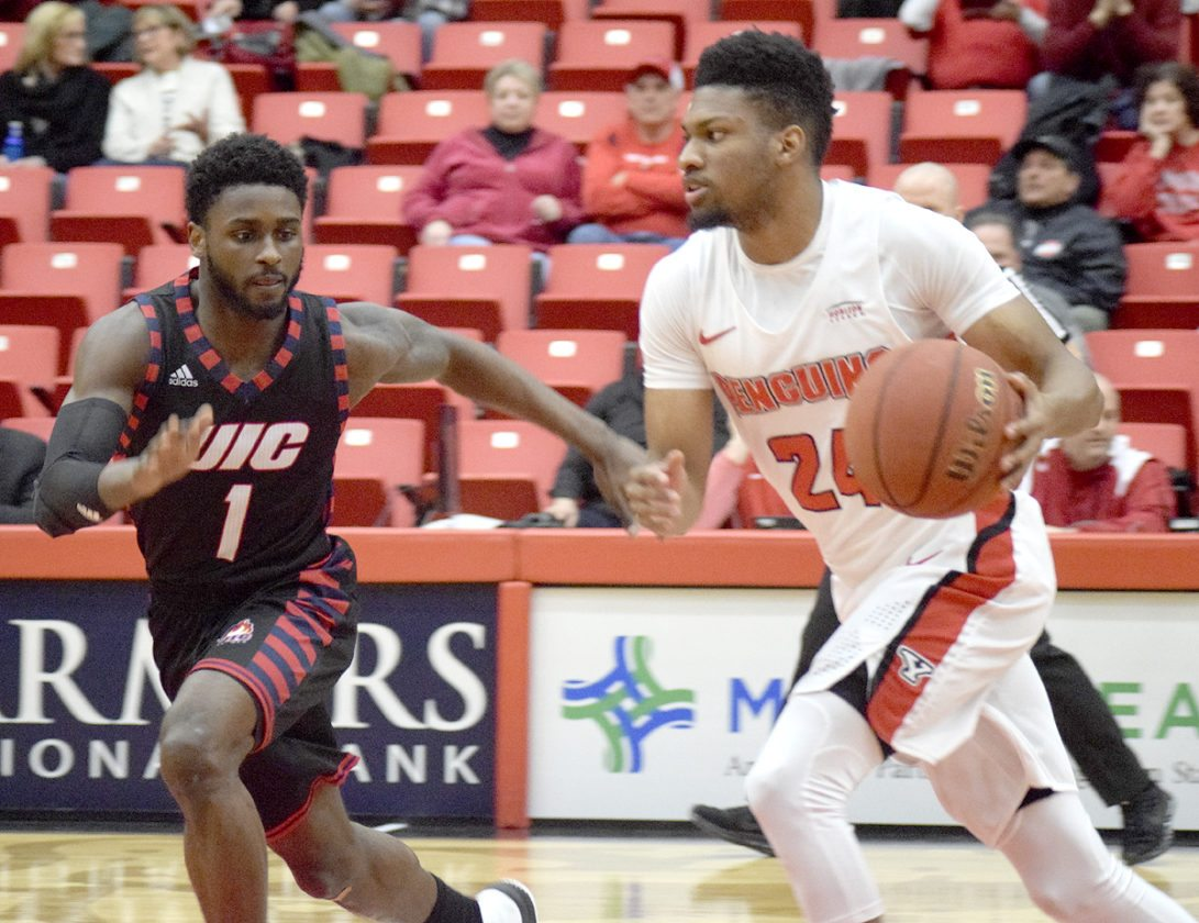 Tribune Chronicle / John Vargo UIC's Marcus Ottey guards Youngstown State's Cameron Morse during the first half of Thursday's game in Youngstown.