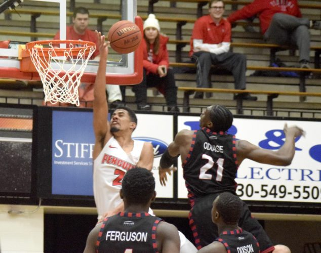 Tribune Chronicle   John Vargo Youngstown State's Devin Haygood cannot convert on a layup Thursday in Youngs-town. Haygood, who had 13 points, was defemded on the play by UIC's Tai Odiase (21), who had 17 points and five blocked shots in the Flames' 92-78 victory. Odiase set the Horizon League's all-time blocks record, breaking the previous mark held by former YSU center and Warren G. Harding graduate Damian Eargle.