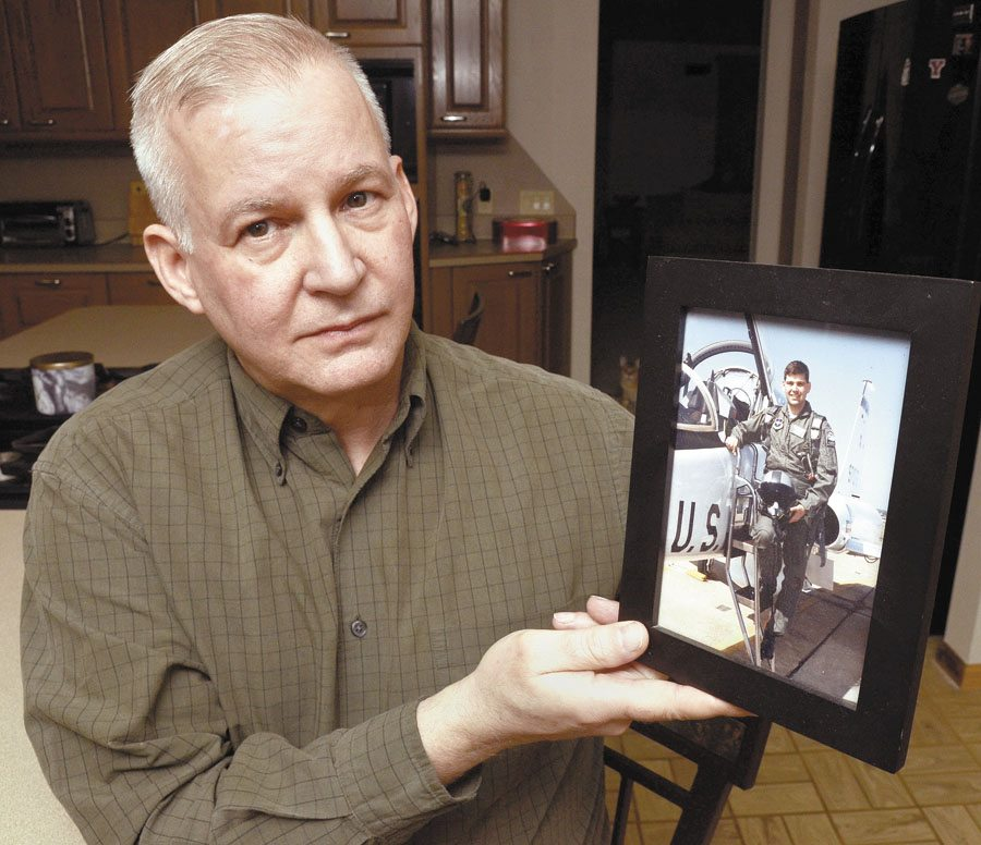 Tribune Chronicle / R. Michael Semple  Paul Hoerig of Howland shows a photograph of his brother Karl in his Air Force uniform. After nearly 11 years since Karl Hoerig was slain in his Newton Falls home, his wife, Claudia, is back in Trumbull County to face trial on a charge of aggravated murder in the March 2007 shooting death of her husband. She fled to Brazil within days of the murder and has been fighting extradition ever since.
