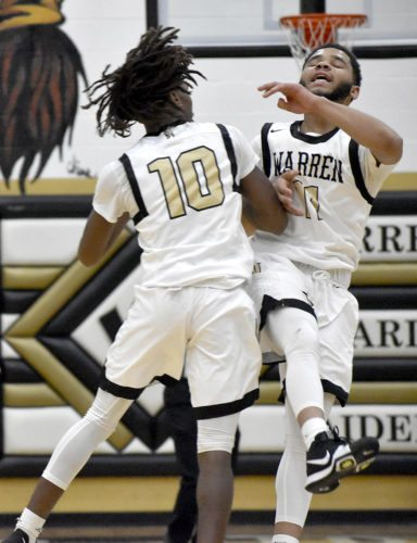Tribune Chronicle / Joe Simon D'Muntize Owens (10) and Trivell Trimble celebrate Trimble's go-ahead 3-pointer Friday night in Warren G. Harding's 53-47 win over Boardman.