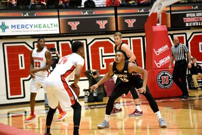 Tribune Chronicle / John Vargo IUPUI's Ron Patterson guards YSU's Cameron Morse Saturday in Youngstown.