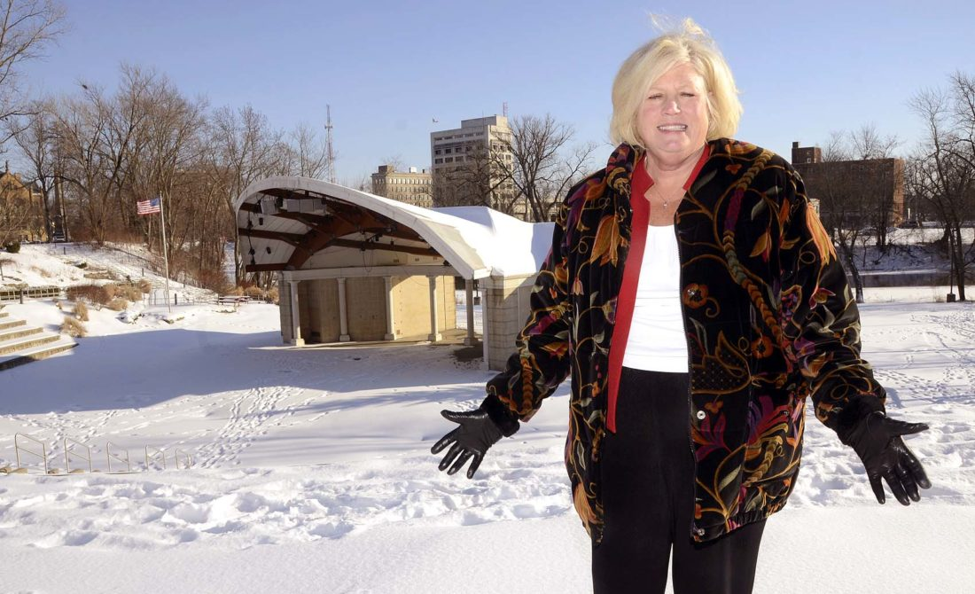 Warren Rotary Club member Diane Sauer stands outside the Warren Community Amphitheatre. Sauer claims Warren's former mayor promised the Rotary naming rights to the facility, but council is debating selling those same naming rights. Tribune Chronicle / R. Michael Semple