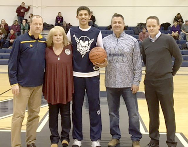 Special to Tribune Chronicle McDonald senior Braedon Poole, center, was honored before a recent Blue Devils' game for scoring 1,000 points in his career. On hand with Poole were, from left, McDonald coach Jeff Rasile; Poole's grandmother, Debbie Bigley; high school Principal Gary Carkido and Superintendent of schools Kevin O'Connell.