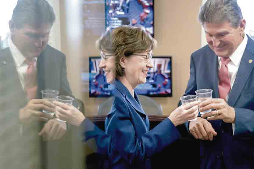 AP Sen. Susan Collins, R-Maine, left, and Sen. Joe Manchin, D-W.Va., right, clink glasses in a toast to each other as they wait to speak at a news conference on Capitol Hill in Washington Monday after Senators reached an agreement to advance a bill ending the government shutdown.