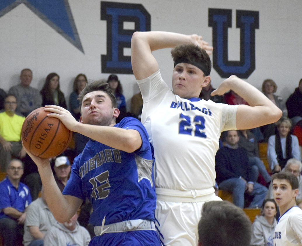 Tribune Chronicle / John Vargo Hubbard's Shannon Slovesko tries to shoot as Lakeview's Drew Munno defends during Tuesday's game at Lakeview High School.