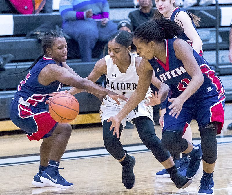 Special to Tribune Chronicle / Dianna Oatridge Brayleonna Woods, center, of Warren G. Harding tries to escape Fitch defenders Jada Lozaro, left, and Daria Williams in Wednesday night's game.